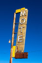 Vintage, neon, decrepit motel sign with a sky background Stock Photos