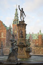 Vintage Neptune fountain at Frederiksborg castle. Denmark Royalty Free Stock Photo
