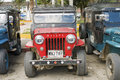 Vintage off road vehicles salento colombia june willy jeeps ready to take trekkers on the dirt roads crossing cocora valley on Royalty Free Stock Images