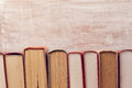 Vintage old books over wooden background. Education Royalty Free Stock Photo