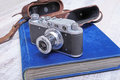 Vintage old film photo-camera in leather case and album Royalty Free Stock Photo