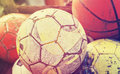 Vintage old film stylized used balls in basket. Royalty Free Stock Photo
