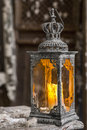 Vintage old lamp for the candle on wooden table Stock Photos