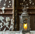 Vintage old lamp for the candle on wooden table Royalty Free Stock Photo