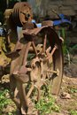 Vintage old rusty iron wheels of a tractor. selective focus Royalty Free Stock Photo