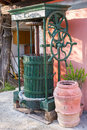 Vintage olive press with wooden barrel terracotta jar Royalty Free Stock Photo