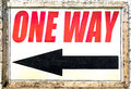 Vintage one way sign with black arrow showing direction Royalty Free Stock Photo