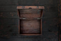 Vintage open chest close up on dark wooden table Royalty Free Stock Photo