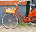 Vintage orange bike in amsterdam with a basket Royalty Free Stock Image