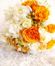 Vintage orange ivory white wedding bouquet on lace background Stock Images