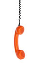 Vintage orange telephone handset over white background Royalty Free Stock Photos