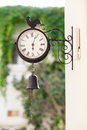 Vintage outdoor chime with a bell hanging photo of Royalty Free Stock Images