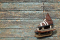 Vintage pair of  ice skates hanging on a cracked paint wall Royalty Free Stock Photo