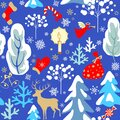Vintage paper blue seamless background with Christmas pattern with snowy firs, trees, reindeer, angel, candle, candy, sock, mitten
