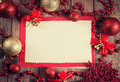 Vintage paper with christmas decoration on wooden background Stock Photo