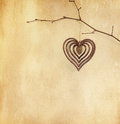 Vintage paper with heart hanging on branch Royalty Free Stock Photos