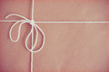 Vintage parcel effect wrapping paper tied with string Stock Image