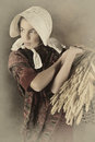 Vintage peasant girl reenactment image of a victorian holding a basket Stock Images