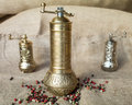 Vintage pepper mills metallic with colored peppercorns Royalty Free Stock Images