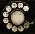 Vintage phone dial closeup of black with copy space in center Royalty Free Stock Photo