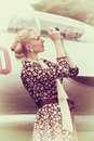 Vintage photo of beautiful girl and plane stylized with camera on background Royalty Free Stock Image