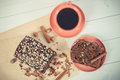 Vintage photo, Dark cake with chocolate, cocoa and plum jam, cup of coffee, delicious dessert Royalty Free Stock Photo