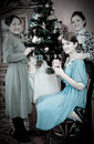 Vintage photo daughters with mother near Christmas Stock Photography