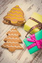 Vintage photo decorated gingerbread and gifts for christmas on old wooden background christmas time fresh baked homemade cookies Royalty Free Stock Image