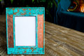 Vintage photo frame on wooden table background with empty white canvas Royalty Free Stock Photo