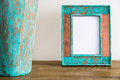 Vintage photo frame on wooden table over white wall background Royalty Free Stock Photo