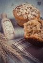 Vintage photo, Fresh muffins with oatmeal, rye flour and ears of rye grain, delicious healthy dessert Royalty Free Stock Photo