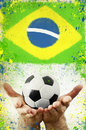 Vintage photo of hands holding soccer ball and Brazil flag Royalty Free Stock Photo