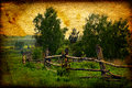 Vintage photo landscape countryside old fence foreground Stock Photo