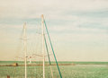 Vintage photo of lighthouse tower and ship masts nautical texture background Stock Photos