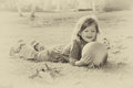 Vintage photo of little beautiful girl playing in the park retro old style filtered image Stock Photo
