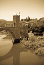 Vintage photo of medieval bridge old stone with gate Royalty Free Stock Images