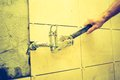 Vintage photo of plumbers hands tightening a water pipe. Royalty Free Stock Photo
