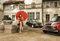 A vintage photo of a young woman with an umbrella Royalty Free Stock Photo