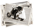 Vintage photos with newlywed young just married posing on an old gray scooter Stock Photo