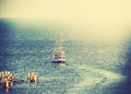 Vintage picture of old sailing ship leaving port Royalty Free Stock Photo