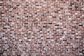 Vintage pink, black and red brick wall background texture. Architecture grunge detail abstract theme. Home, office or loft design Royalty Free Stock Photo