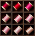 Vintage pink and red spools of thread Stock Images