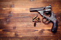 Vintage pistols on wooden background Royalty Free Stock Photos