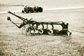 Vintage plow in a farm field an old sits outside on filtered to give retro look Stock Photo
