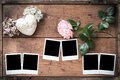 Vintage polaroid photo frame polaroids on wooden boards with rose and heart Royalty Free Stock Images