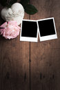 Vintage polaroid photo frame polaroids on wooden boards with rose and heart Royalty Free Stock Photos
