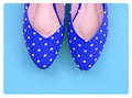 Vintage polka dot shoes on blue background Royalty Free Stock Photo