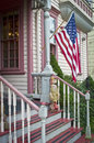 Vintage porch an old with an american flage in historic clinton new jersey Royalty Free Stock Photography