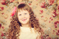 Vintage portarait little girl with long curly hair Royalty Free Stock Image