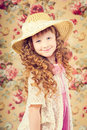 Vintage portarait little girl with long curly hair Royalty Free Stock Photography
